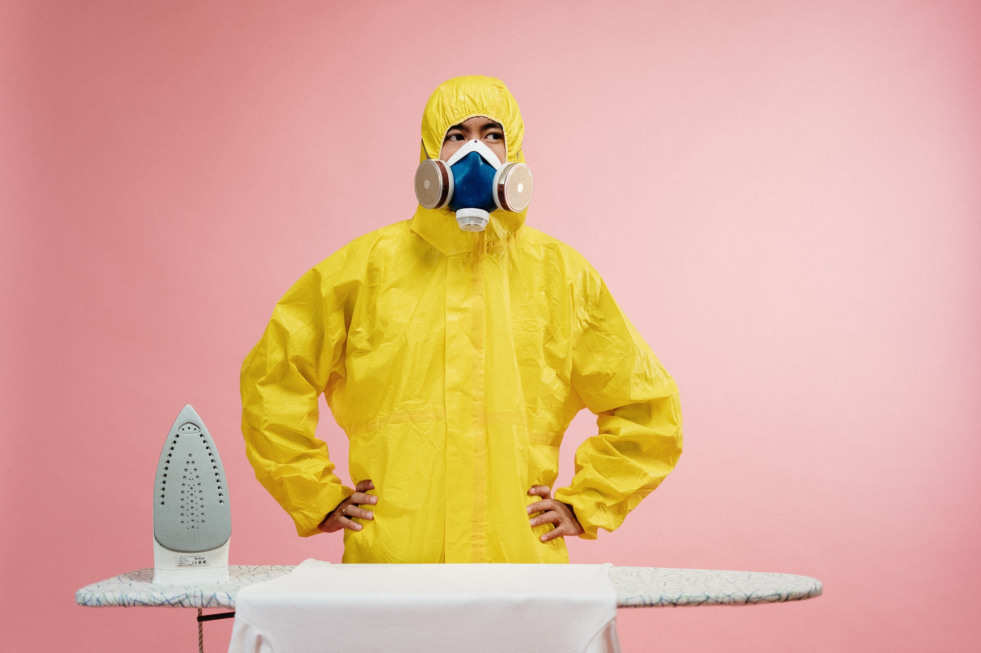 man-in-coveralls-standing-by-ironing-board-3951358